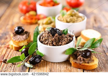assorted of antipasto, tapenade with tree branch