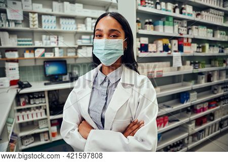 Happy Female Woman Working In Pharmacy Standing Behind Counter Wearing Labcoat And Covid-19 Face Pro