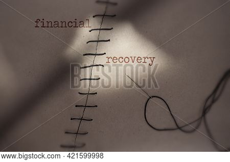 Torn Piece Of Paper Sewn Together With Financial Recovery On Each Side