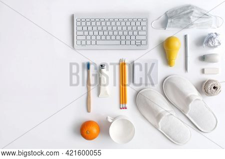 Work From Home Top View Of Workspace Stationery With Yellow Light Bulb In The Centre, Symbolising In