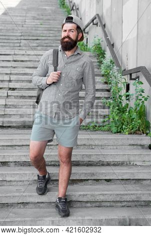 Go Somewhere. Brutal Hipster With Travel Backpack. Hiking Adventure Concept. Urban Style. Mature Hip