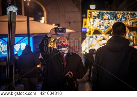 Belgrade, Serbia - December 26, 2020: Selective Blur On An Old Senior Man Wearing A Facemask With Th