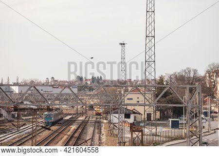 Mladenovac, Serbia - March 28 2021: Selective Blur On Tracks And Building Of Mladenovac Train Statio