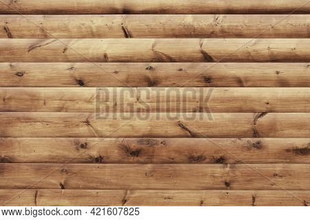 Orange Wood Block House Siding Material Background. Brown Natural Wood Barn Texture. Rustic Reclaime