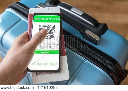 Close Up Of New Immunity Covid-19 Health Passport Digital Green Pass With Boarding Pass For Travel