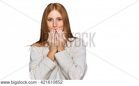 Young irish woman wearing casual winter sweater laughing and embarrassed giggle covering mouth with hands, gossip and scandal concept
