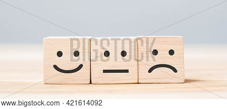 Emotion Face Symbol On Wooden Cube Blocks. Service Rating, Ranking, Customer Review, Satisfaction An