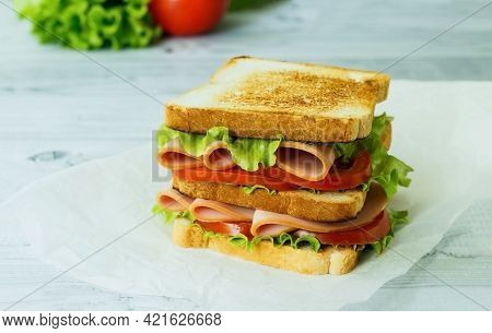 .cold Cut Turkey Sandwich On Whole Wheat With Ham, Lettuce, Tomato On Wooden Background.