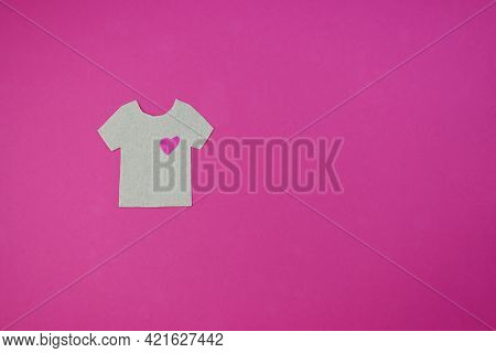 Beige T-shirt Made Of Paper On A Pink Background. T-shirt With A Heart.