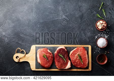 Raw Beef Meat On Kitchen Board. Top View Flat Lay With Copy Space For Recipe