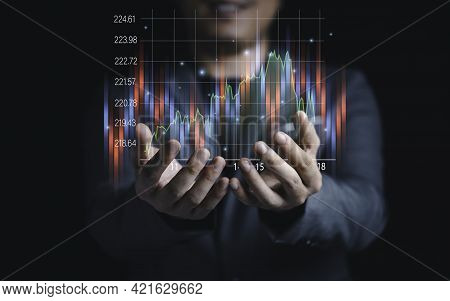 Stock Market Investment And Trading Concept , Businessman Holding Stock Market Investment Chart.