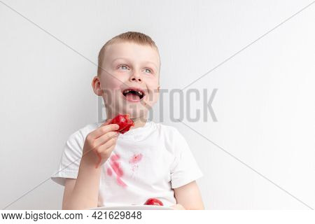 Toothless Boy Eating Strawberry And Spilling Juice On T-shirt. Isolated On A White Background. The C