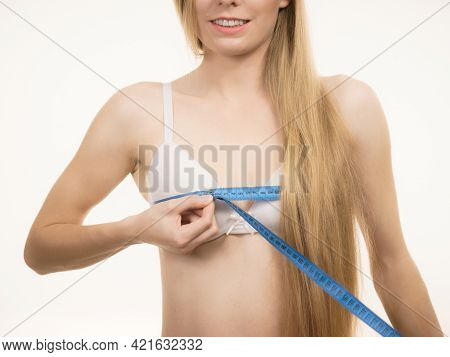 Young Woman Wearing White Bra Using Tape Measure To Check The Measurements Of Her Chest Breasts. Bos