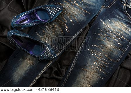 Glamorous Womens Fashion A Jeans And Shoes In Rhinestones. Top View. Fashion Background