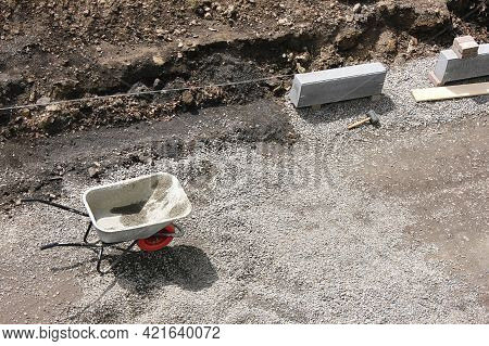 Road Repairs. Installation Of A New Curb Stone Before Laying Asphalt. Working Trolley. Road Works.