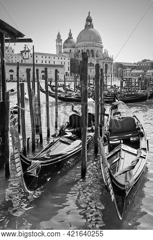 Gondolas on Grand Canal in Venice, Italy. Black and white venetian view