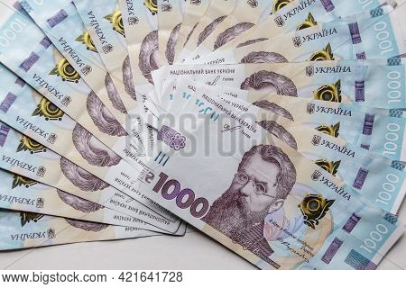 Ukrainian Money Hryvnya On A White Background. The National Currency Banknotes. Close Up Finance Bac