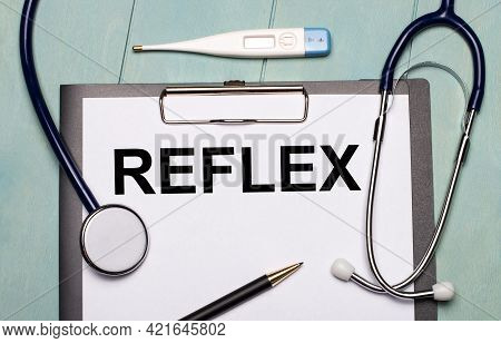 On A Light Blue Wooden Background, There Is A Paper Labeled Reflex, A Stethoscope, An Electronic The