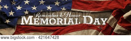 US American flag covering distressed and worn wood. Wallpaper for USA Memorial Day with Remember and Honor Memorial Day.