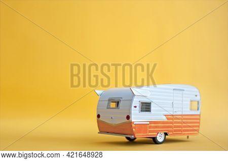 Close Up Of Camper Van On Orange Backdrop