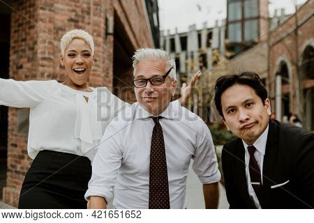 Businesspeople being goofy in the city