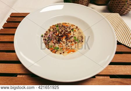 Traditional Middle Eastern Europe Red Lentil Soup In White Plate On Wooden Background - Top View. Ph