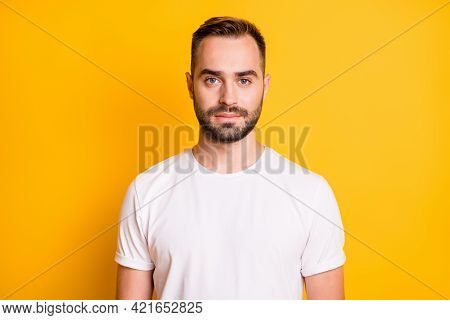Portrait Of Optimistic Guy Wear White T-shirt Isolated On Vibrant Yellow Color Background
