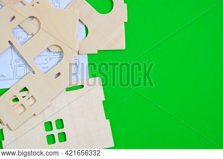 Details And Instructions, Constructor Of Prefabricated Wooden Orphanage On Green Background