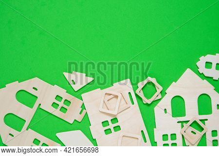 Details Of Constructor Of Prefabricated Wooden Orphanage On Green Background