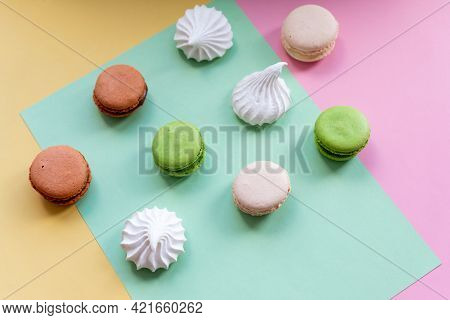 Pop Art Color Style Macaroons And Bakery Goodies On Bright Colorful Background.variety Of Macaroons.