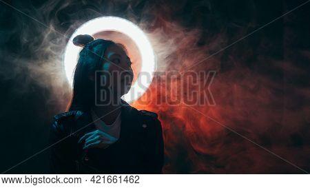 Night People Banner. Cyberpunk Style. Apocalyptic Future. Blue Neon Light Asian Girl In Black Leathe
