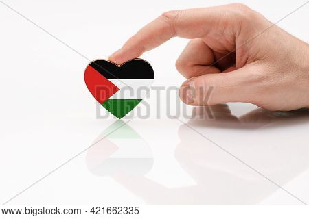 Palestine Flag. Love And Respect Palestine. A Man's Hand Holds A Heart In The Shape Of The Palestine