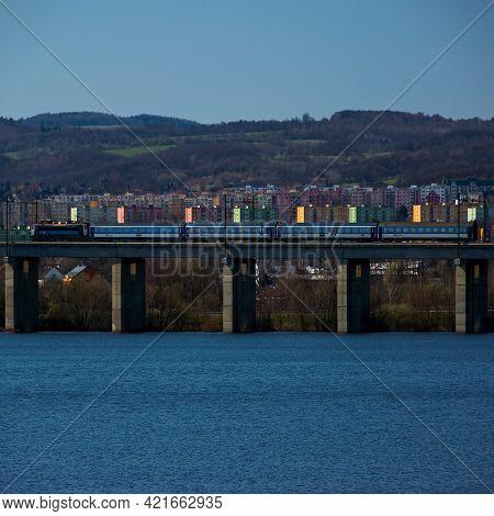 Chomutov, Czech Republic - April 04, 2021: Train On Bridge, Sunny Weather