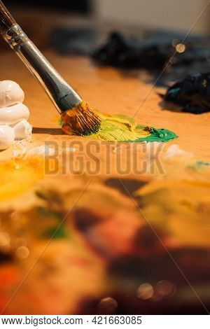 Acrylic Painting Art. Artist Tools. Creative Process. Paintbrush Blending Orange Green Black Oil Pai