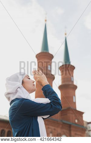 Muslim Woman Prayer Wear Hijab Fasting Pray To Allah On Mosque Background