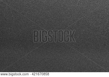 Cloth. The Background Is Made Of Dark Colored Fabric. A Texture Or Pattern From A Material. A Piece