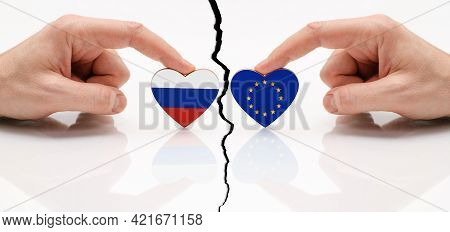 Concept Of Disagreement Between The Eu And Russia. Flags Of The European Union And Russia In The Sha