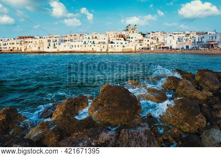 Picturesque view of Naousa town with greek orthodox church in famous tourist attraction Paros island, Greece with traditional whitewashed houses