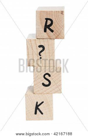 Risk Tower Spelt With Wooden Blocks.