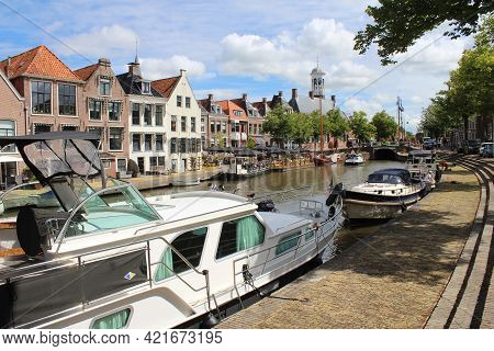 Dokkum, Netherlands, 22 July 2020: View Of The Klein Diep Canal And Waterside Buildings From The Vle