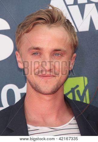 LOS ANGELES - JUN 05:  TOM FELTON arriving to MTV Movie Awards 2011  on June 05, 2011 in Hollywood, CA