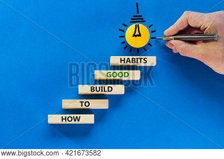 Build Good Habits Symbol. Wooden Blocks On Blue Background, Copy Space. Light Bulb Icon. Businessman