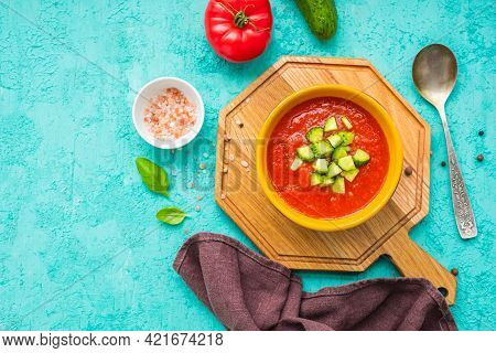 Tomato Gazpacho, Traditional Spanish Cold Soup Or Appetizer In A Yellow Clay Bowl On A Wooden Board