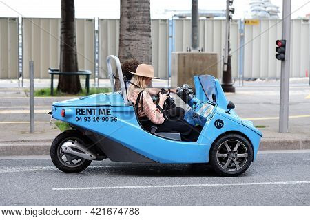 Nice, France - May 21, 2019: Young Couple Of Tourists In Small Blue Rental Car From Nicecar, Funny T