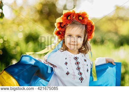 Vyshyvanka Day. Child In Traditional Embroidery With Blue And Yellow Flag Of Ukraine. Ukraines Const