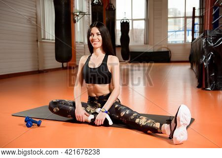 Fitness, Sport, Workout, Gym And Lifestyle Concept - Young Woman Stretching In The Gym