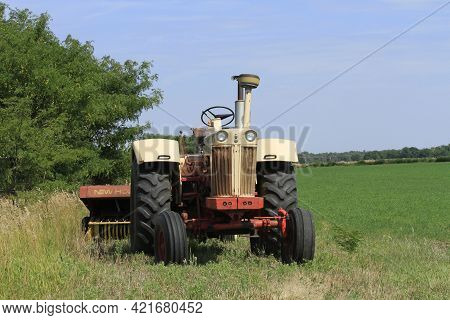 International Tractor With A New Holland  Baler On The Back In A Alfalfa Field Ready For Harvest Wit