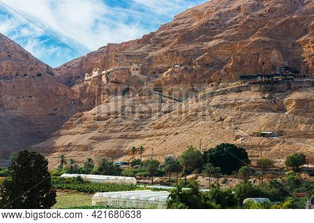 The Monastery Of The Temptation On The Red Rocks. The Mount Of Temptation In Jericho, Palestine. Oas