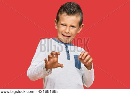 Adorable caucasian kid wearing casual clothes disgusted expression, displeased and fearful doing disgust face because aversion reaction. with hands raised