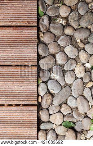 Brown Wood  And Cobblestone Walkway Panels In The Home Garden